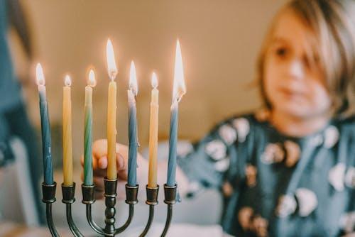 Boy Lighting Menorah