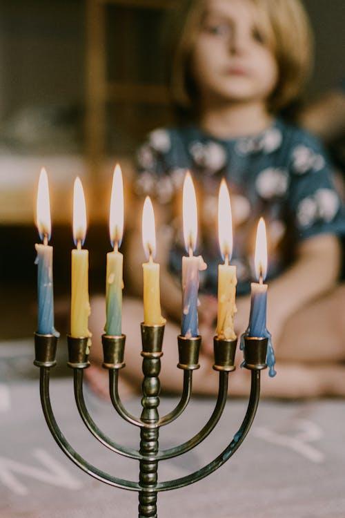 Lit Candles on Menorah