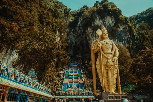 Gold Statue Near Green Trees