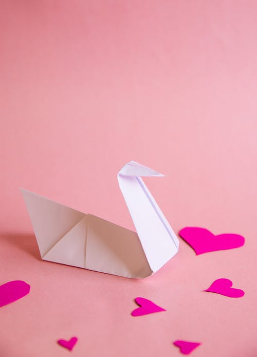 White Paper Boat on Pink Heart Paper