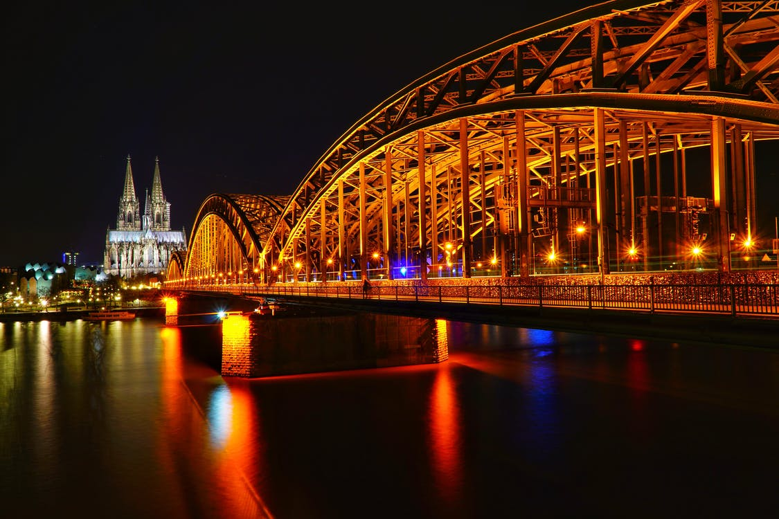 Lighted Bridge and View of Church at Nighttime