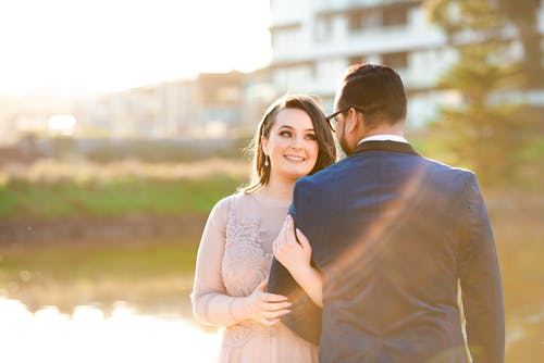 Couple in love smiling near lake