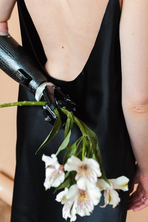 Woman in Black Slip Dress Holding White Flower