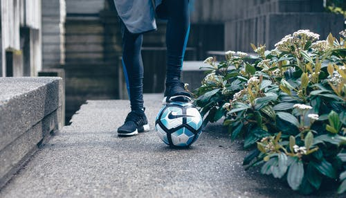 Person in Black Leggings Stepping on Nike Soccer Ball