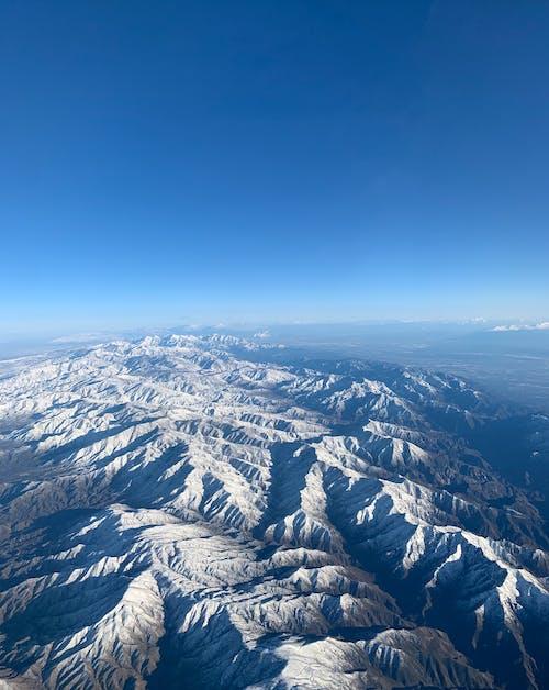 Безкоштовне стокове фото на тему «блакитне небо, Блакитні гори, вершина гори, високий»