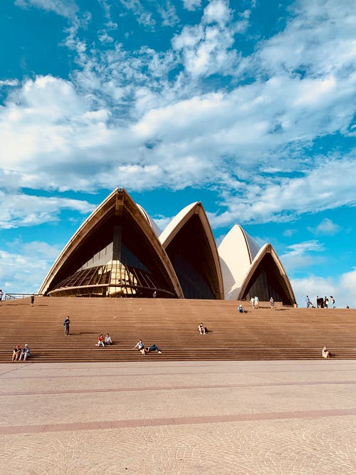 Tourists near Sydney Opera House on sunny day