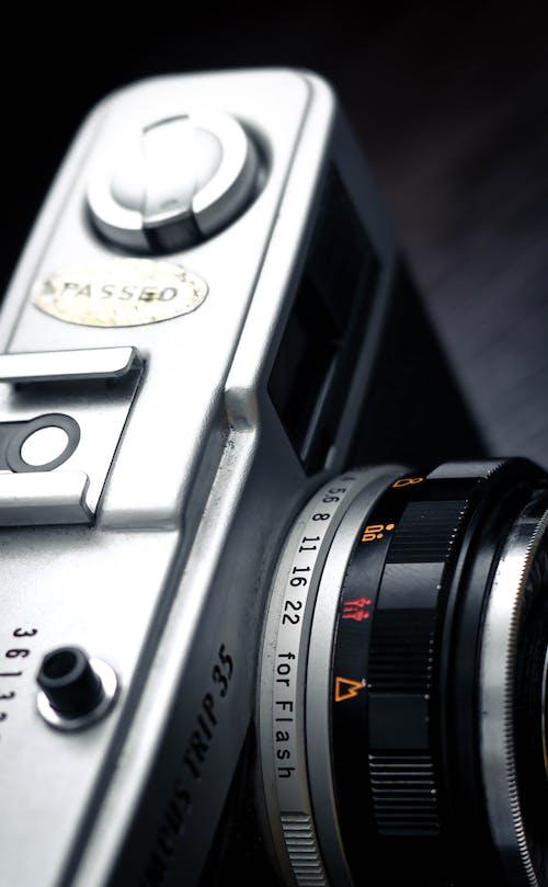 Retro fashioned photo camera on table