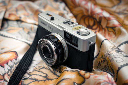 Old fashioned camera on piece of cloth