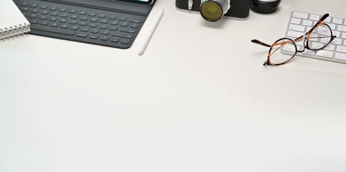 Photo Of Eyeglasses On Keyboard