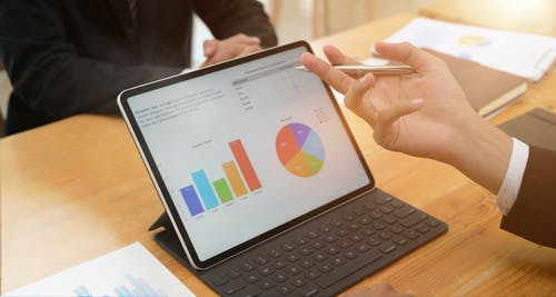 Photo Of Person Holding Black Tablet
