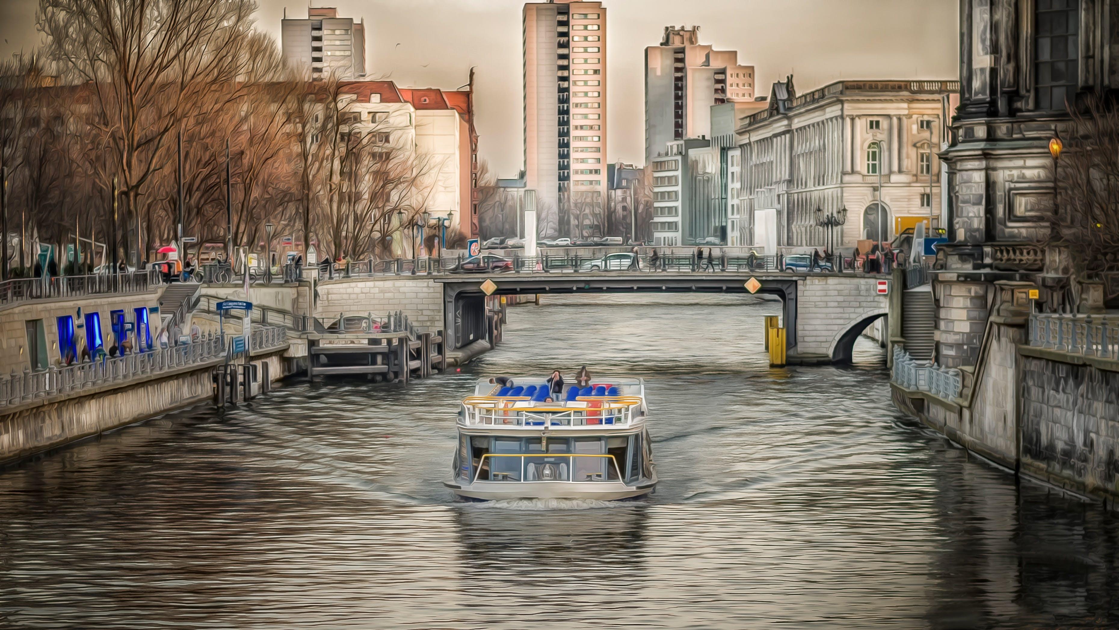 White Powerboat Under Gray Bridge