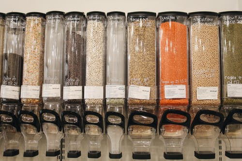 Variety of Spices in Glass Dispensers