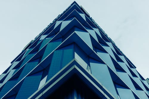 Low Angle Photography of Blue Concrete Building