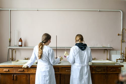 Women In White Laboratory Gown Standing