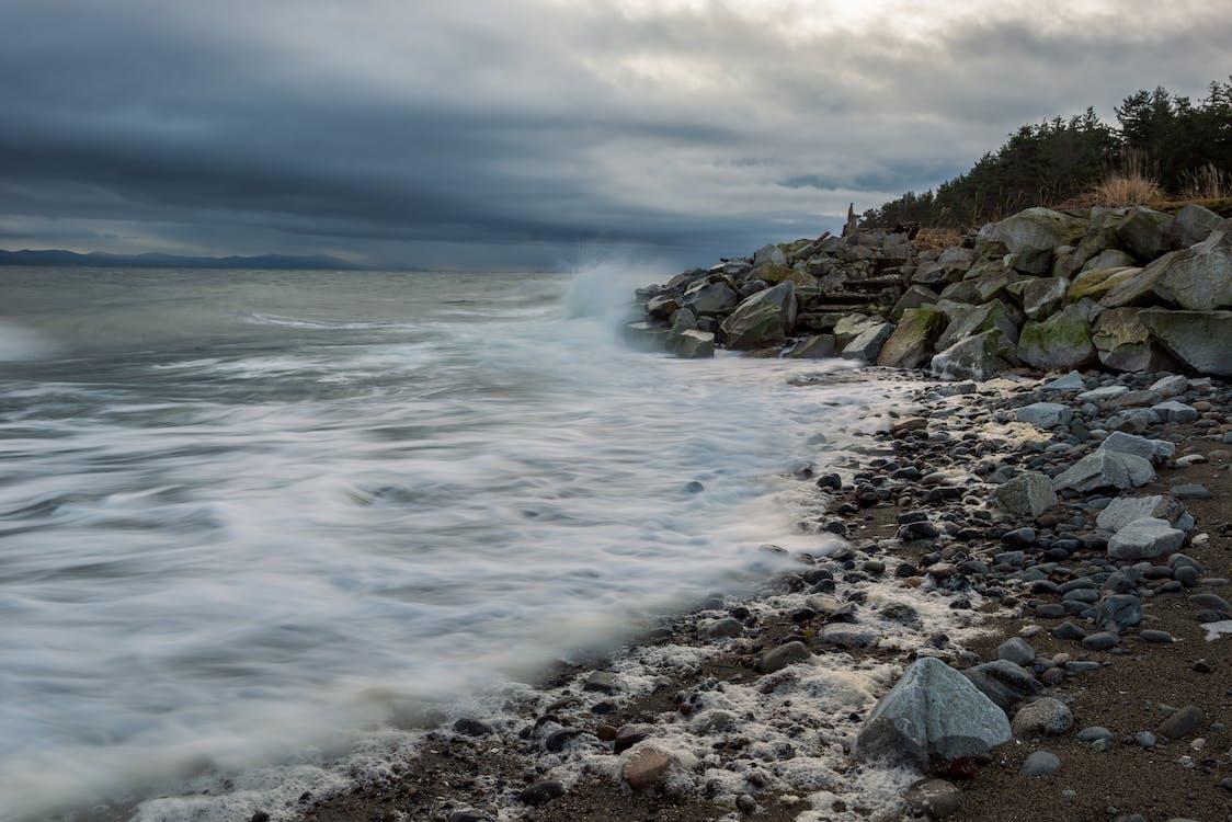 Rocky Shore Under Cloudy Sky