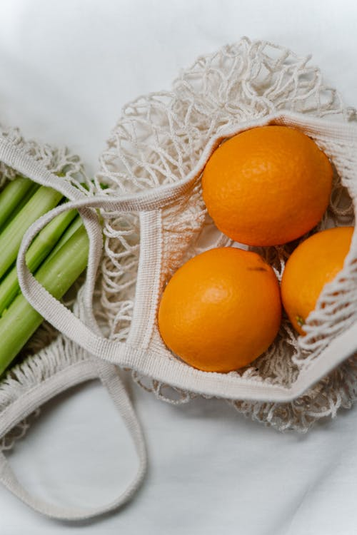 Orange Fruit In White Net Bag