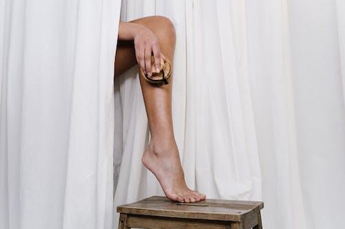 Person Scrubbing Her Leg