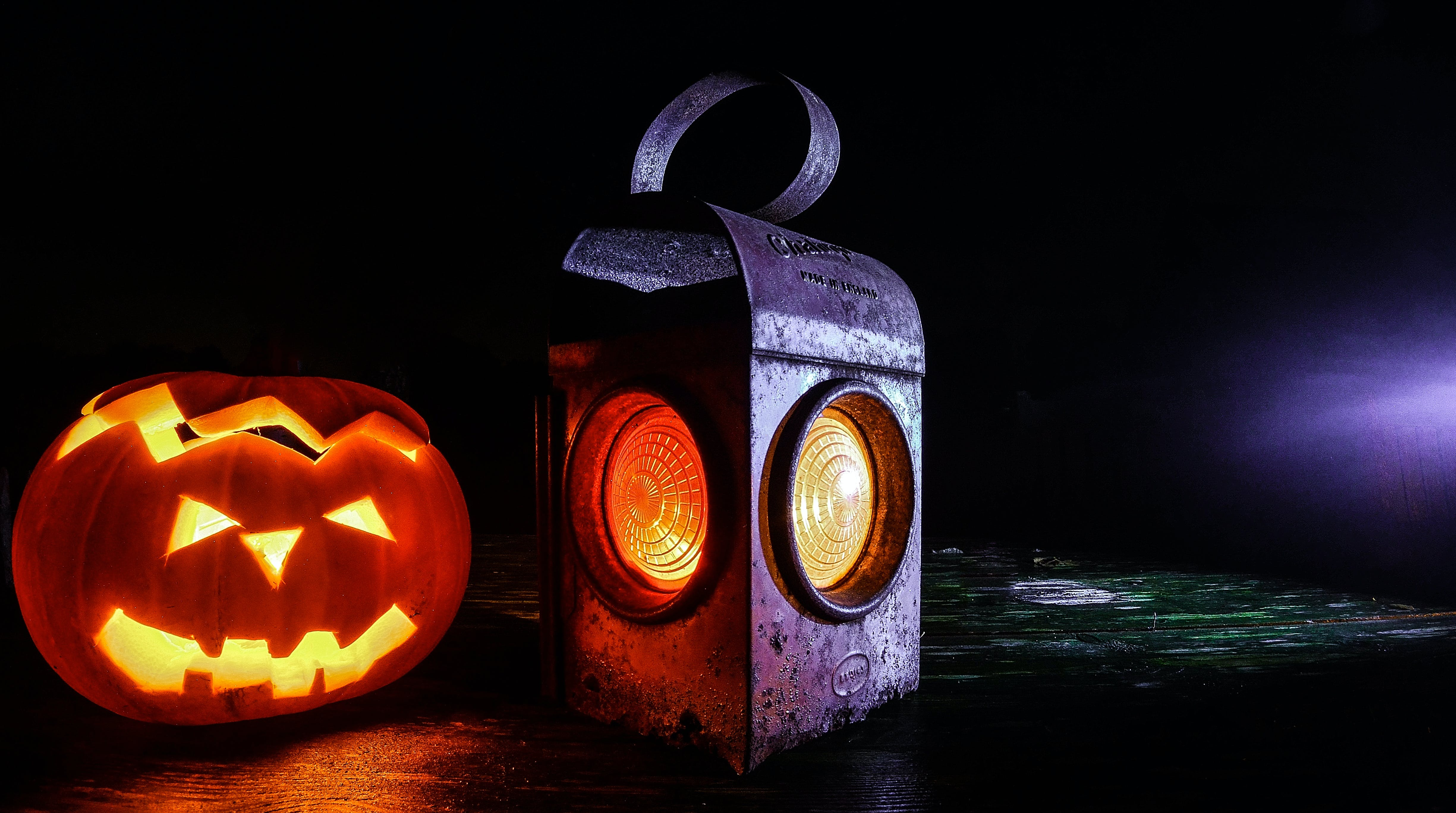 Jack O'lantern Beside Black Lantern