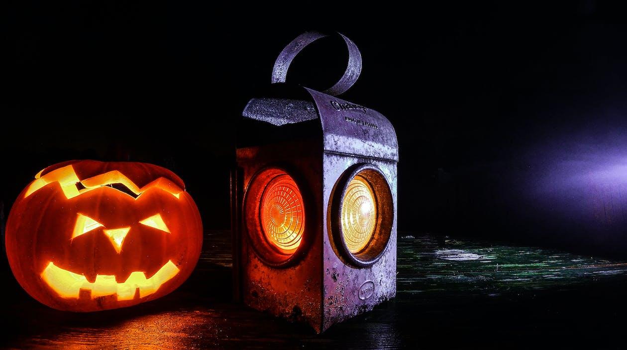 Jack O'lantern Beside Black Lantern