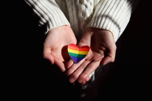 Person Holding Colorful Heart Shaped