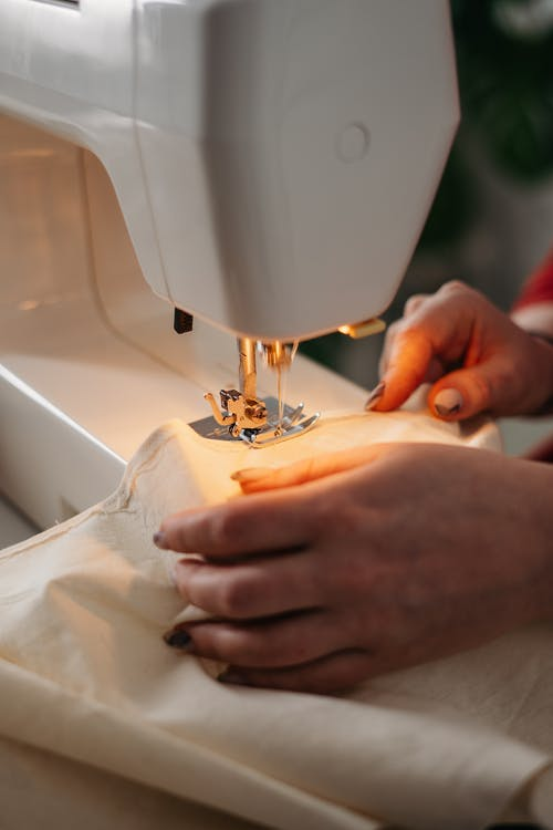 Person Using a Sewing Machine