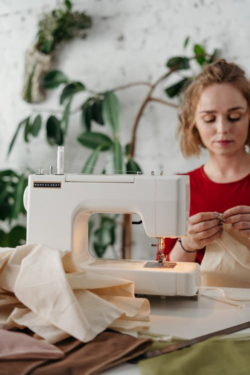 Woman in Red Shirt Sewing