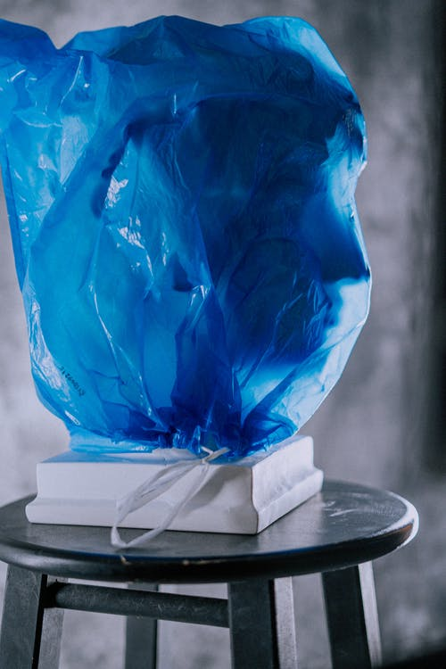 Photo of Blue Plastic Bag on Stool