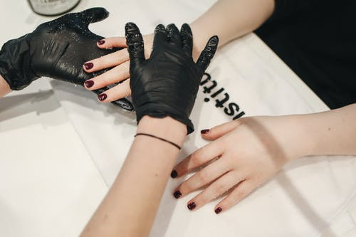 Person Wearing Black Gloves