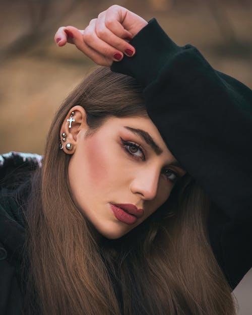 Woman in Black Hoodie Wearing Silver Ear Studs