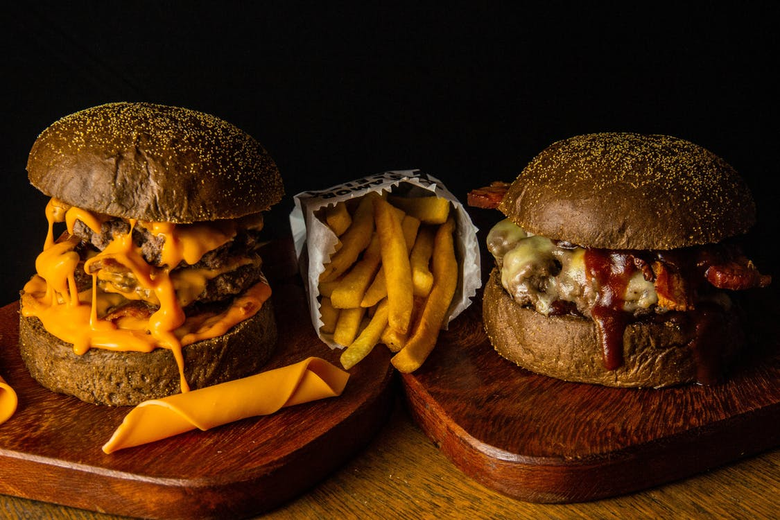 Two Burgers With Fries and Sauce