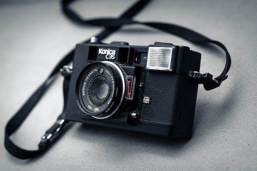 Black Konica C35  Camera on Grey Textile