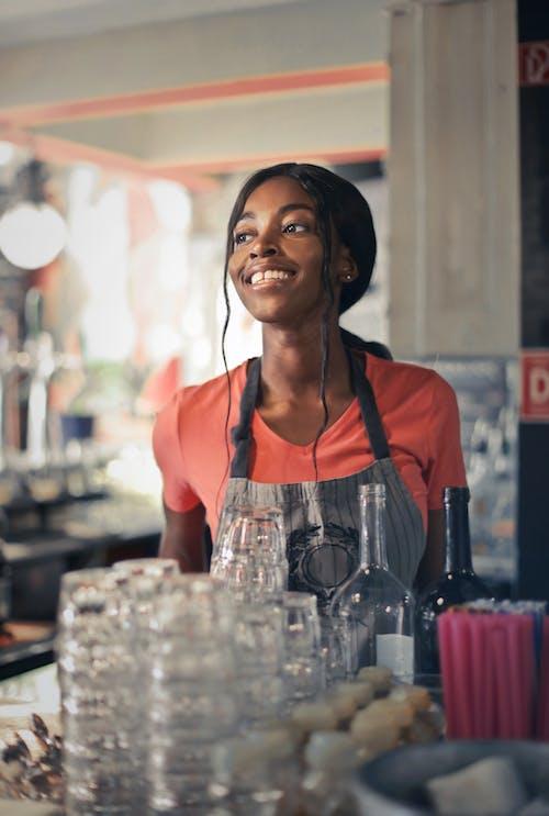 Woman in Orange T-Shirt Smiling