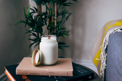 Milk Filled Jar on Book