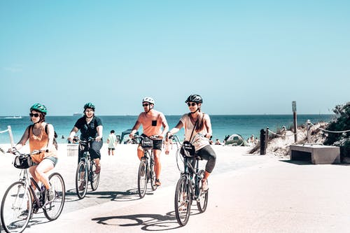 People Riding Bicycles on Beach