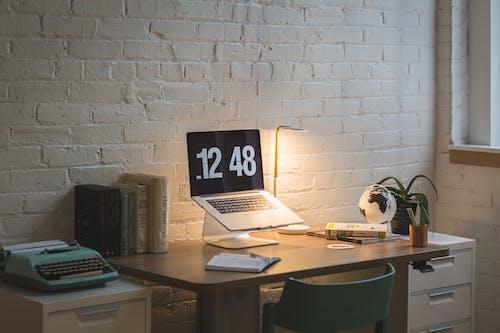 Macbook on Desk Beside Table Lamp