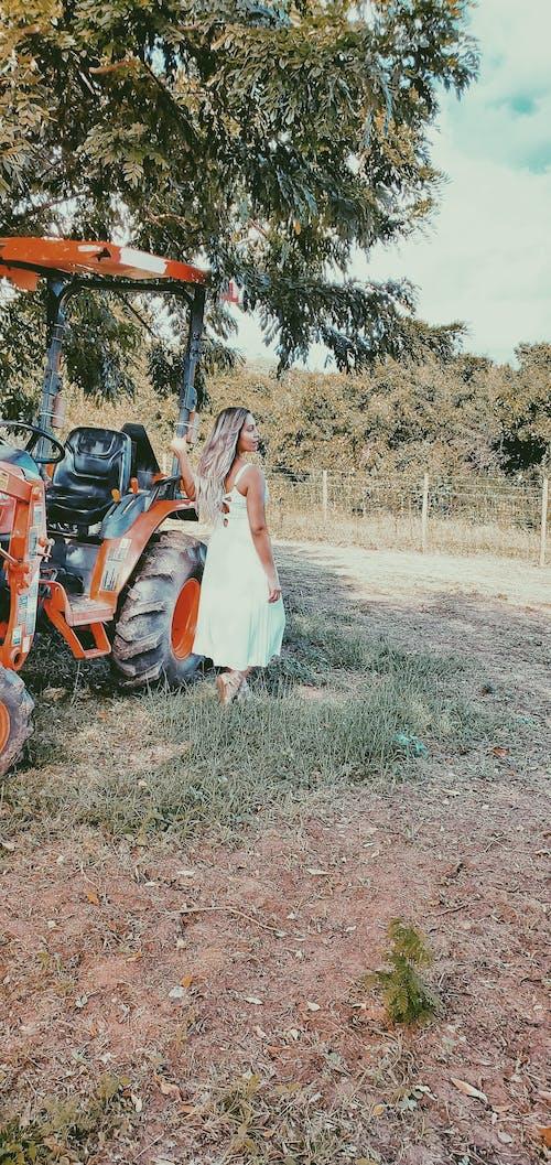 Free stock photo of beautiful woman, farm, farm equipment