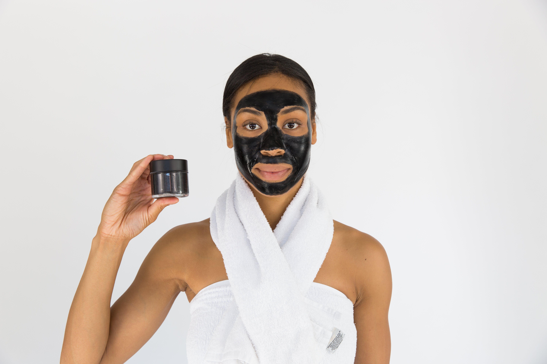Woman Holding Black Mask