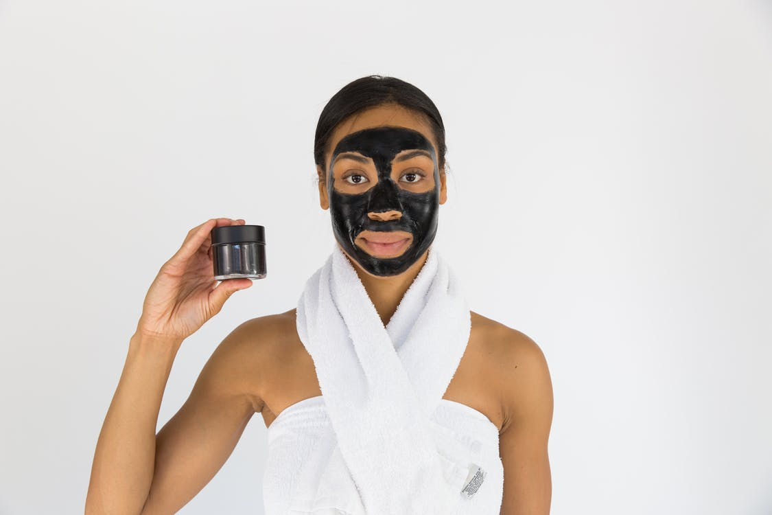 Woman Holding Black Mask