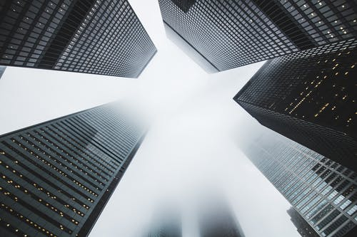 Low-angle Photography of Buildings Covered by Fog
