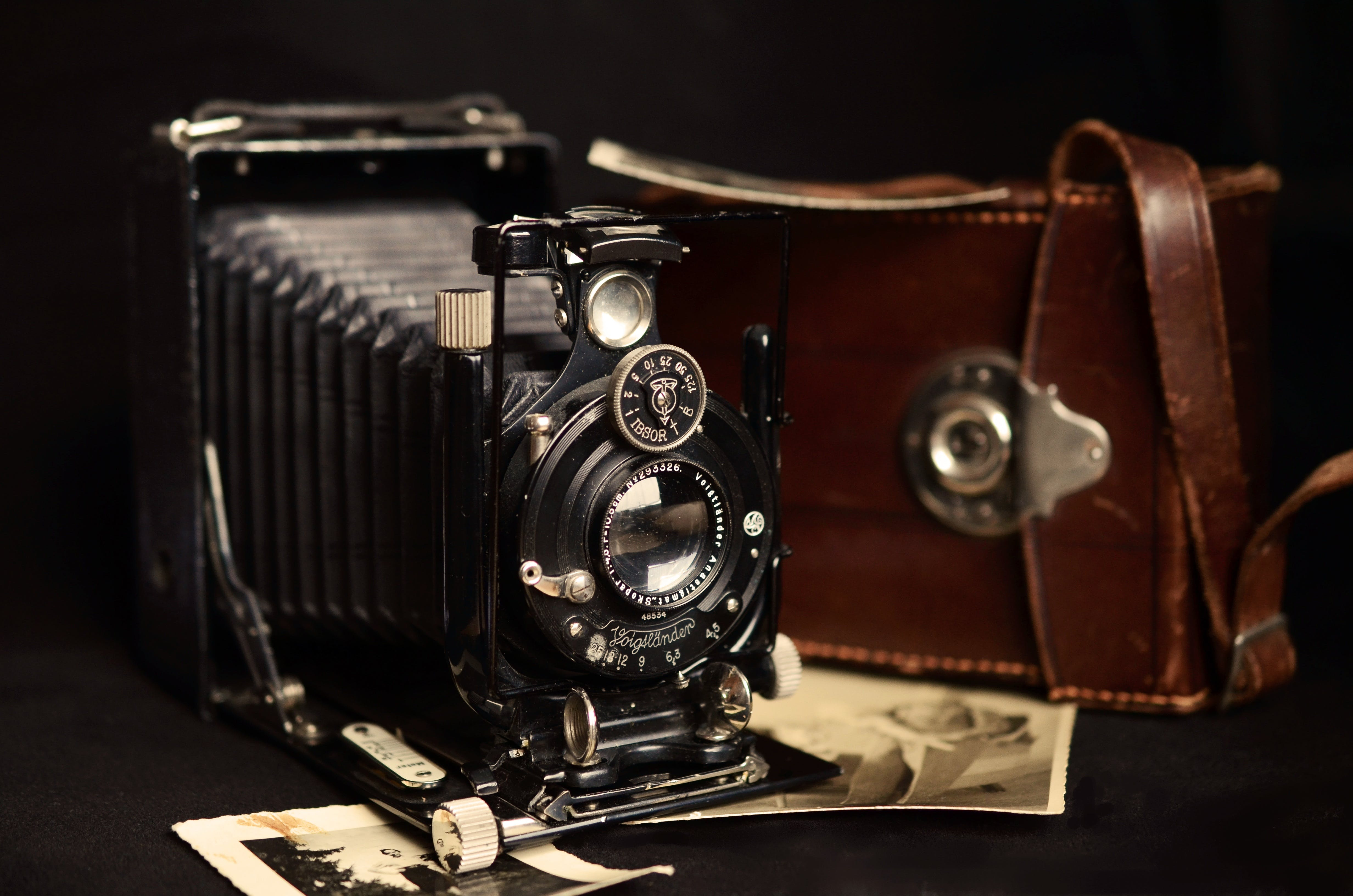 Black Classic Camera Near Brown Leather Bag