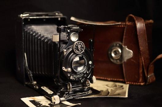 Black Classic Camera Near Brown Leather Bag