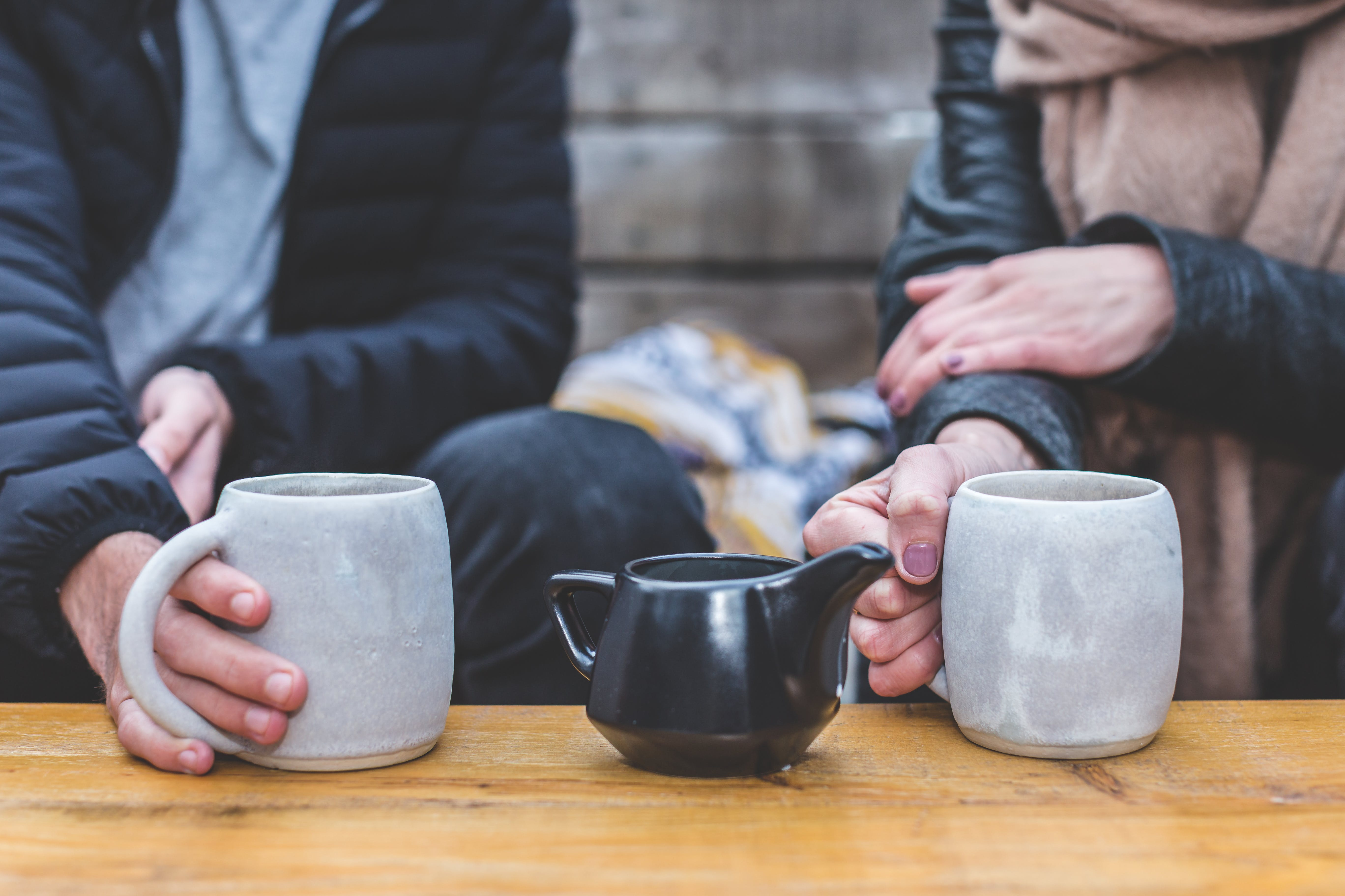 Man and Woman Having a Tea Conversation