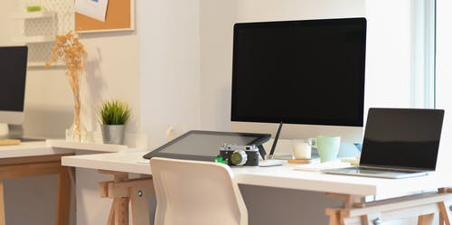 Black Desktop Computer on White Wooden Table