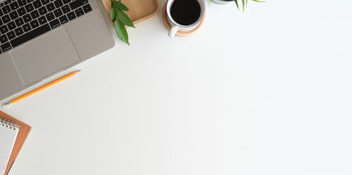 White Ceramic Mug on White Table