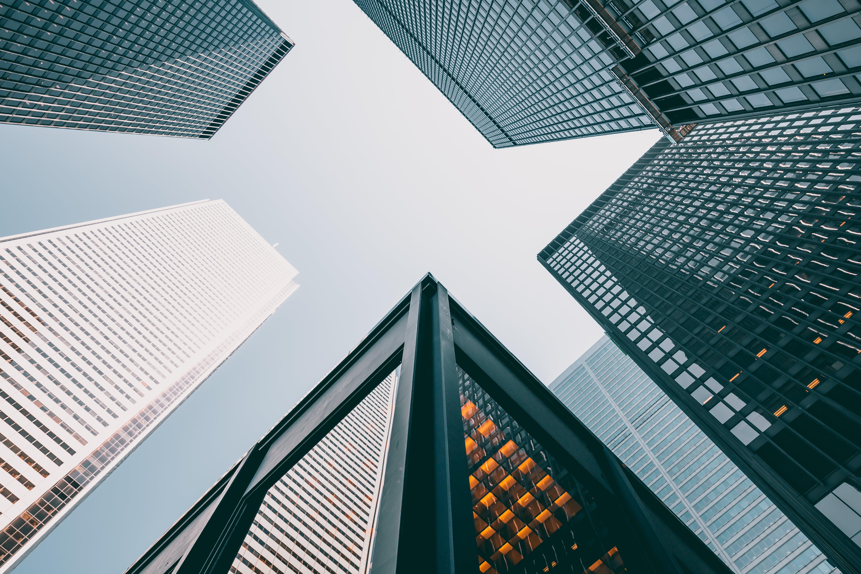 Five Gray Concrete Buildings Under Blue Sky