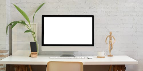 Silver Imac on White Wooden Desk