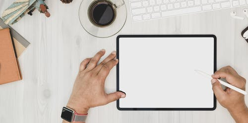 Person Holding Stylus Using Tablet Computer