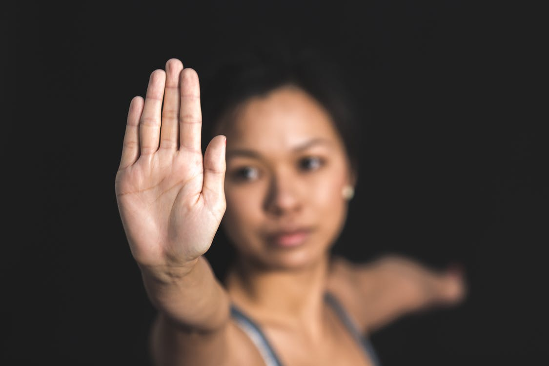 Woman Raising Right Hand