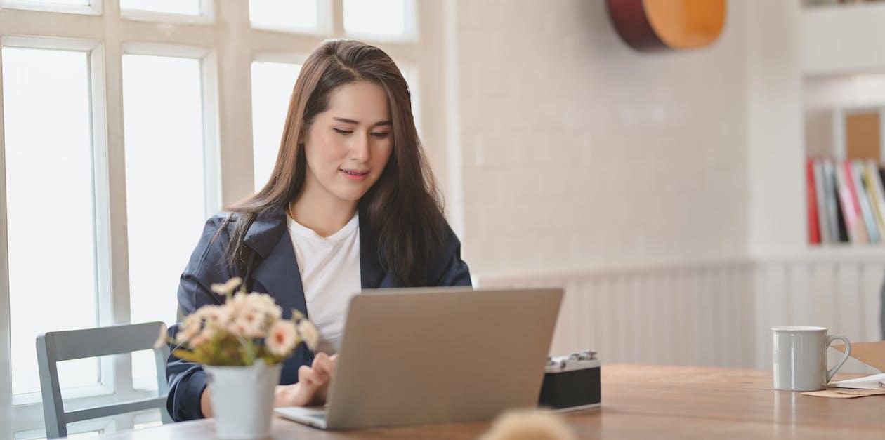 Woman in Black Blazer Using Laptop Computer