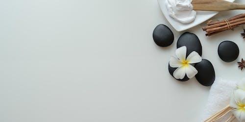 Various spa supplies arranged on white background